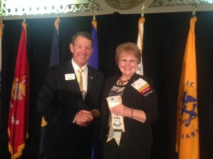 President Evelyn Brady receiving Five Star Level of Excellence Award from Gen Robertson, MOAA Chairman of the Board. Photo courtesy of Maj Gen Buck Marr