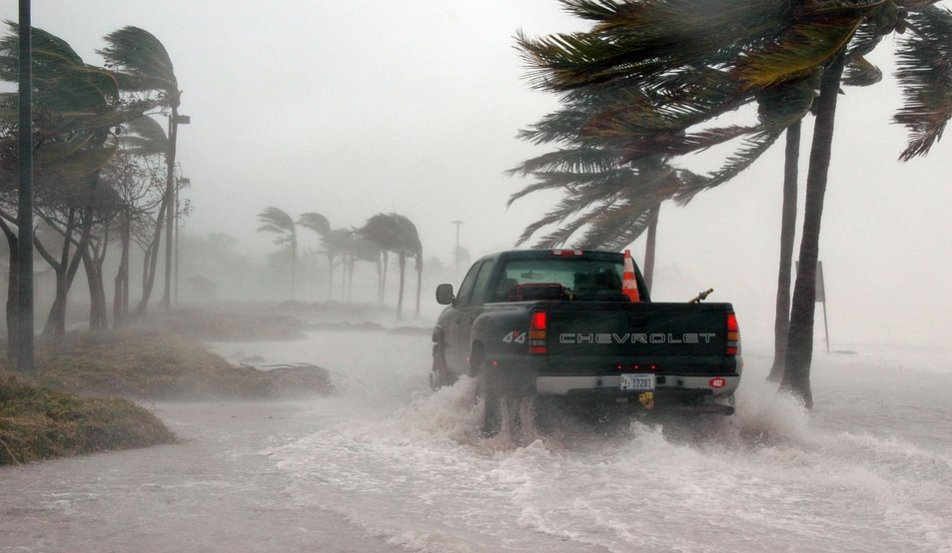 A truck driving through a hurricane