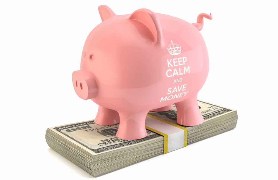 piggy bank on top of a stack of money