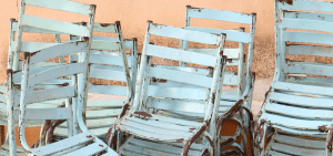Stacks of pastel blue, rustic chairs