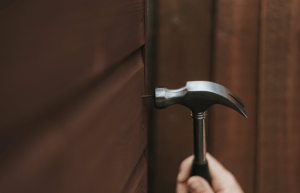 Hammer against a nail on the wall