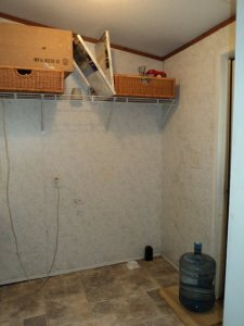 Inside mobile home laundry room - before photo