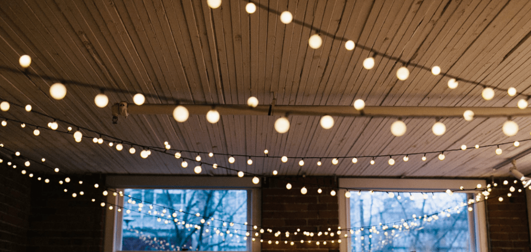 String lights with round bulbs hung across the ceiling