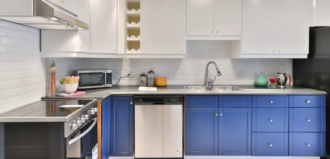 White kitchen with blue cabinets on the bottom