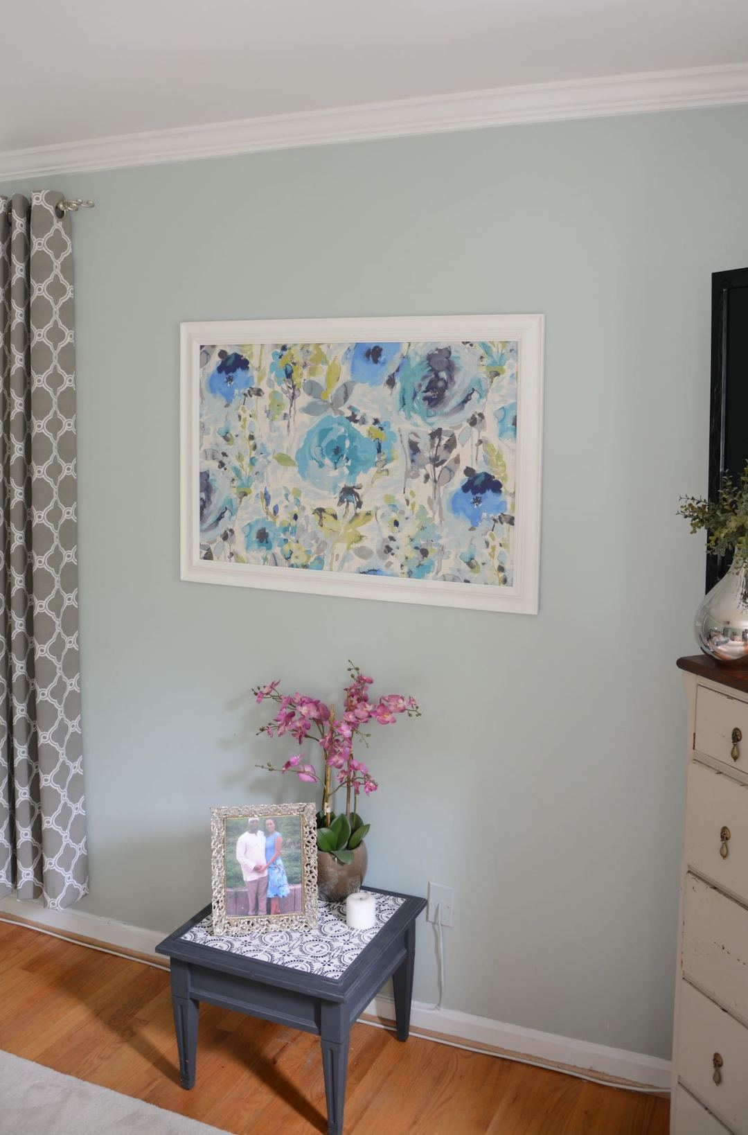Framed fabric hung on the wall