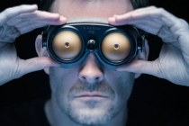 Man looking at viewer through x-ray glasses