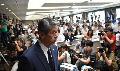 Toshiba President Hisao Tanaka (C) arrives for a press conference at the company's headquarters in Tokyo on July 21, 2015. Toshiba president Hisao Tanaka and his predecessor Norio Sasaki quit the company on July 21 as one of Japan's best-known firms was hammered by a 1.2 billion USD accounting scandal blamed on management's overzealous pursuit of profit.    AFP PHOTO / KAZUHIRO NOGIKAZUHIRO NOGI/AFP/Getty Images