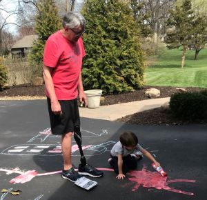 Papa Dan Helps August Decorate The Driveway