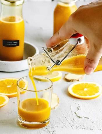 Ein Shot Ginger Orange Shot zur Stärkung der Immunkräfte