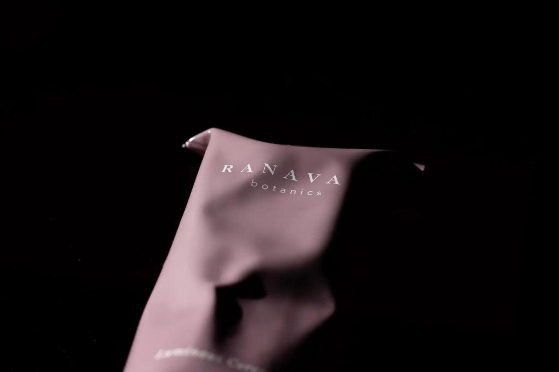 Ranavat pink aluminum creamy cleanser tube on black background. Brand of female entrepreneur, Michelle Ranavat.