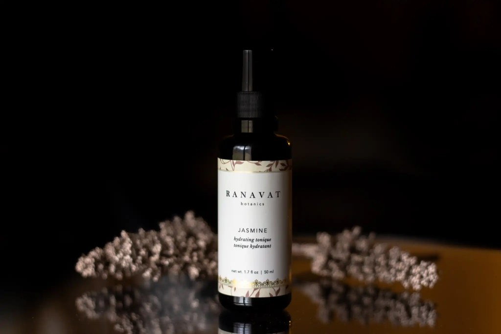 South Asian woman-owned Ayurvedic beauty brand Ranavat Jasmine tonique black bottle on black background,