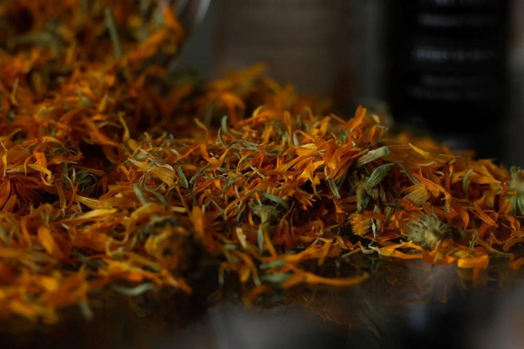 Maison Made dried calendula petals on glass table