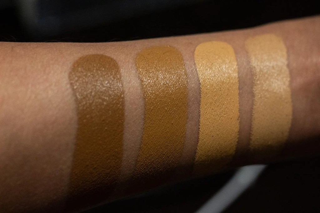 Westman Atelier foundation swatches on brown arm