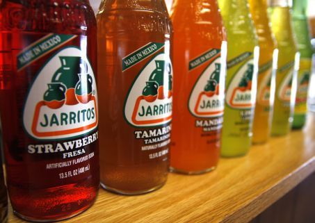 These easy to find Mexican sodas pull double duty as colorful decor and as a refreshing drink