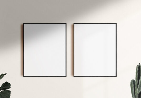 two poster frames on a wall mockup