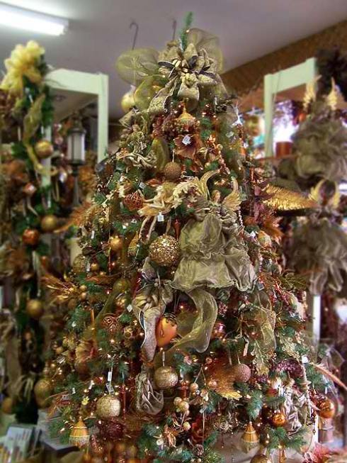 this pre decorated artificial pre lit christmas tree features many glittering tree ornaments that are surrounded with little elves and beautiful angels - Copper Christmas Decorations