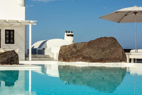 exterior pool of the Beautiful villa in Santorini Greece