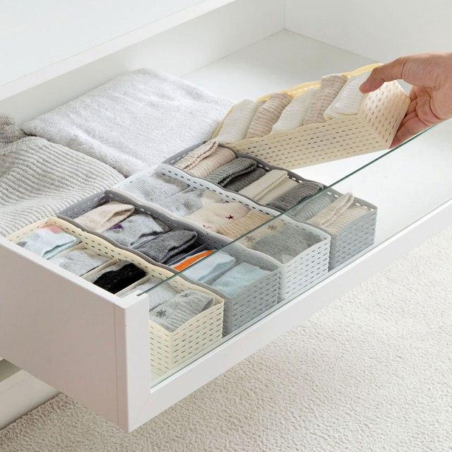 soluzione per cassetti - scatole in plastica per riordinare l'armadio.