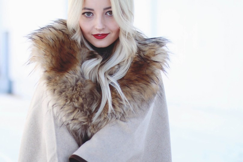 Alena Gidenko of modaprints.com sharing tips on how to wear a faux fur poncho