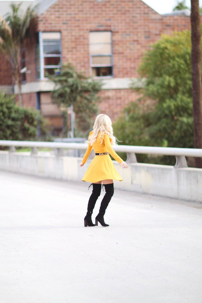 Alena Gidenko of modaprints.com styles a yellow ruffled dress with over the knee black boots