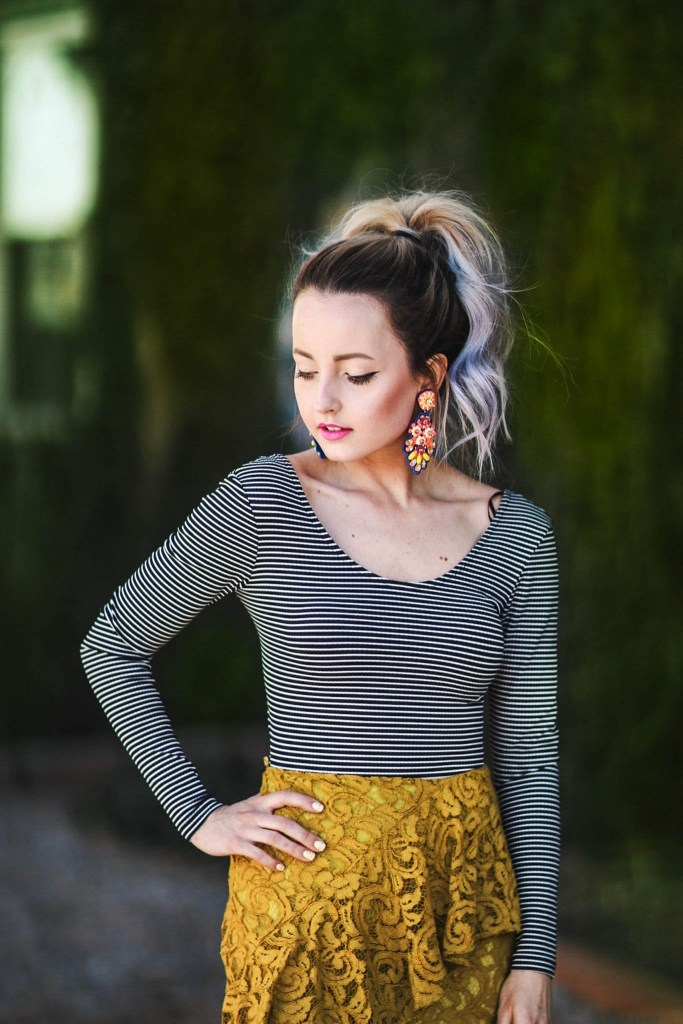 Alena Gidenko of modaprints.com styles a striped open back onsie with a lace yellow skirt from TopShop