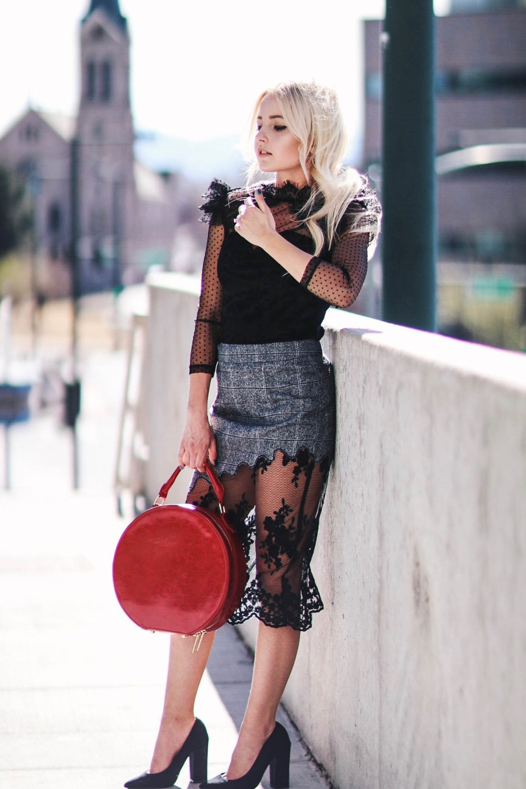 Alena Gidenko of modaprints.com styling a black sheer top with a grey pencil skirt