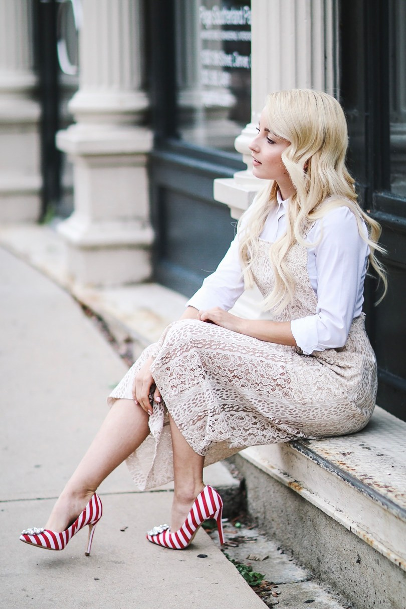 Alena Gidenko of modaprints.com styles a lace cream romper with a white button up and spices up the look with fun striped red heels