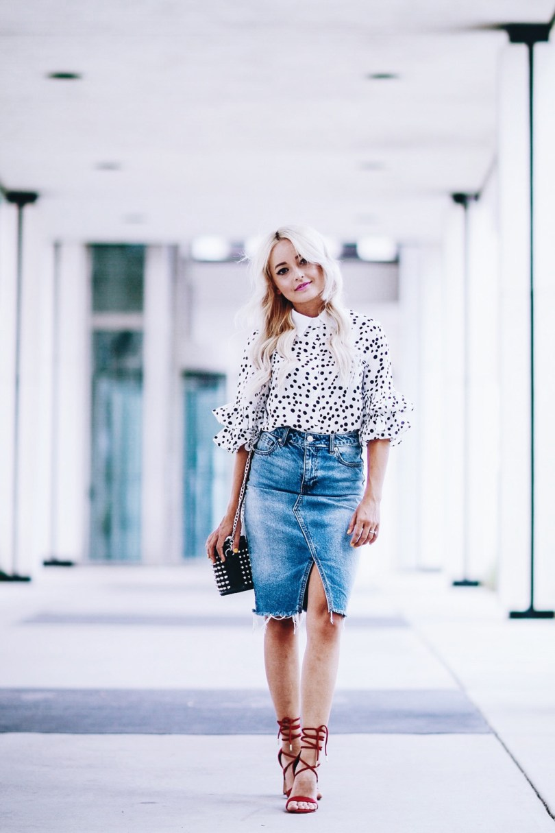 Alena Gidenko of modaprints.com styles a denim pencil skirt with a polka dot blouse