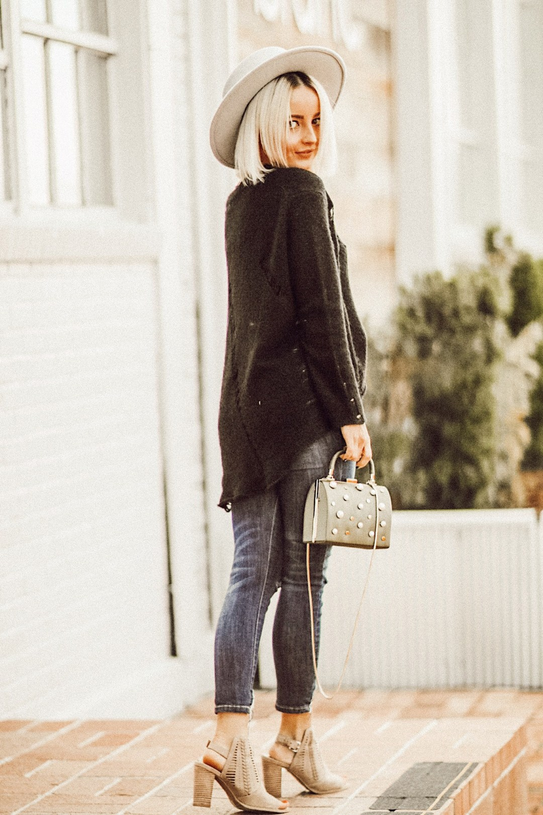 Alena Gidenko of modaprints.com shares tips on how to style booties for a girls night out with Famous Footwear