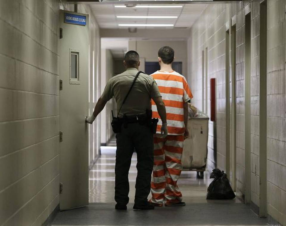 In this Feb. 21, 2013, file photo, an inmate at the Madera County jail is taken to an inmate housing unit in Madera,. In an effort to save money on state prison spending, shoplifting, forgery, fraud, petty theft and other lower-level offenses will now be treated as misdemeanors under the recently passed Proposition 47.