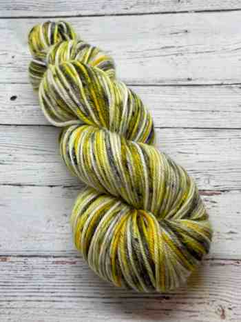 Cream Yarn with yellow areas and black speckles named after Carol Peletier from The Walking Dead television series.