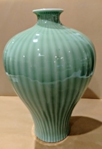"Antique Chinese celadon vase. Qing Lung period. 11.25""h. Orig. List: $926. Modele's Price: 125.-"
