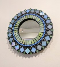 "**ITEM NOW SOLD** Mini 'Zatamari' mosaic mirror by Angie Heinrich. 7.5"" diam. Current List: $70.- Modele's Price: 35.-"