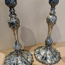 "**ITEM NOW SOLD** Pair silverplated candlesticks. Purchased at The Bon Marche approx. 20 years old. 7""d. x 13.25""h. 125.- pair"