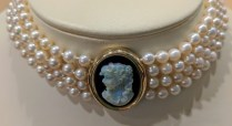Vintage choker: 4 strands pearls, 14K yellow gold setting with an onyx and opal cameo. C. 1960's. 2500.-