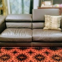 **ITEM NOW SOLD** Roche Bobois Leather Sofa. Discontinued Style. Headrest adjusts up or down. Original List: $8000.- Modele's price: 2500.-