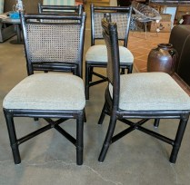 Set 4 McGuire Chairs. Exact age unknown. Double caned backs. 'X' struts on base. Upholstered seats. 1395.-/set.
