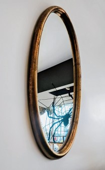 "**ITEM NOW SOLD** Vintage oval mirror. C. 1960's. Wired to hang vertically. 22""w x 49.75"" h. 350.-"