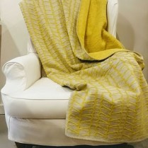 Yellow and Grey Pattern Fuzzy Fussenegger Throw. 165.-