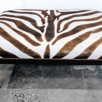 **ITEM NOW SOLD**Plantation Style Zebra hide ottoman. Nailhead trim. Approx 6 years old. 395.-