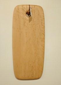 "Edward S. Wohl cutting board. 10"" x 23"" 150.-"