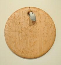 "Edward S. Wohl cutting board. 14"" round 125.-"