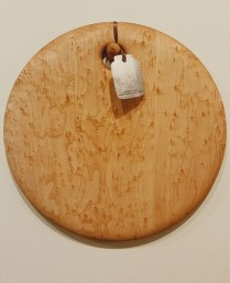 "Birds-eye maple cheese/ bread board. 14"" diam. 125.00"