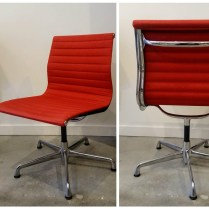 ** ITEM NOW SOLD.**Herman Miller Eames Aluminum Side Chair. Polished Aluminum. Fabric Cover: Poppy.Current Retail Price: $1229. Modele's Price: 595.-