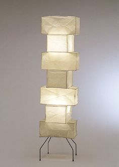 "Akari Isamu Noguchi Light Sculpture. Purchased in 1998 uses up to 60 watt bulb. Current list $995.-. Modele's Price: 550.- 19"" x 76"""