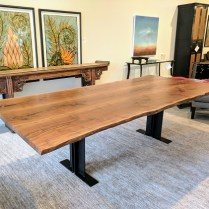 **ITEM NOW SOLD**Urban Hardwoods Custom live edge dining table.Walnut. Original List: $10,400.-Modele's Price: 6950.-