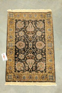 **ITEM NOW SOLD**Small rug. 'Royal Taj Vase' Charcoal/Khaki. Purchased at Pande Cameron. Includes pad. Original List $725.-Modele's Price: 295.-