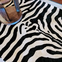 **ITEM NOW SOLD**Tufenkian 'Zebra Stripe' Rug. Purchased 15 years ago at the Seattle Design center. Just cleaned by Andonian. wool. Original List: $4000-5000.Modele's Price: 1950.-