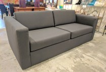 Custom sofa. Built by Wood's Upholstery in 2012. Showroom sample, then stored. Design Tex 'Rocket' #2693-811 in 'graphite'. Commercial grade upholstery. Original Cost: $6000.- Modele's Price: 2500.-