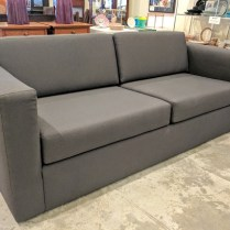 **ITEM NOW SOLD** Custom sofa. Built by Wood's Upholstery in 2012. Showroom sample, then stored. Design Tex 'Rocket' #2693-811 in 'graphite'. Commercial grade upholstery. Original Cost: $6000.- Modele's Price: 1750.-